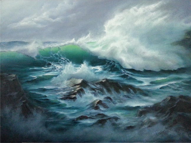 This photo depicts a turbulent ocean breaking over rocks. Waves crash in all directions, and sea foam sprays. The water is blue and teal in color, darkening toward the image's foreground. Ominous gray clouds fill the sky in the top left corner.